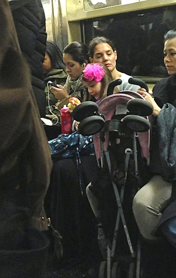 Katie Holmes and Suri Cruise ride the New York subway in Manhattan. Suri was seen eating an apple and holding a water bottle.