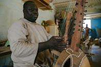 Long-necked kora harps are made with a calabash gourd as the soundbox
