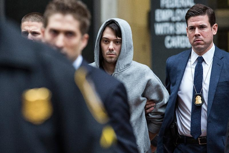 Martin Shkreli (C), CEO of Turing Pharmaceutical, is arrested for securities fraud on December 17, 2015 in New York City (AFP Photo/Andrew Burton)