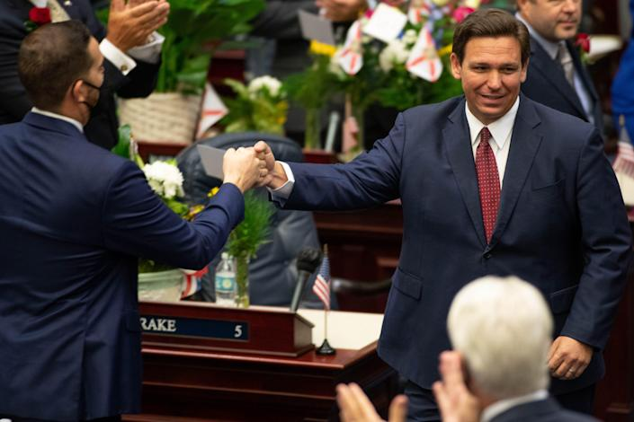 Florida Gov. Ron DeSantis arrives in the state House of Representatives chamber in Tallahassee on Tuesday to give his State of the State speech on the first day of the 2021 legislative session.