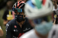 Colombia's Egan Bernal, left, arrives at the the start of the first stage of the Tour de France cycling race over 156 kilometers (97 miles) with start and finish in Nice, southern France, Saturday, Aug. 29, 2020. (AP Photo/Christophe Ena)