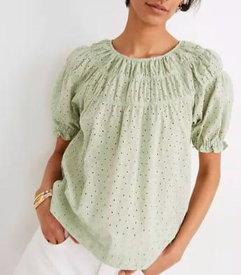 <p>The details on this <span>Madewell Daisy Embroidered Shirred Puff-Sleeve Top</span> ($88) make it special.</p>