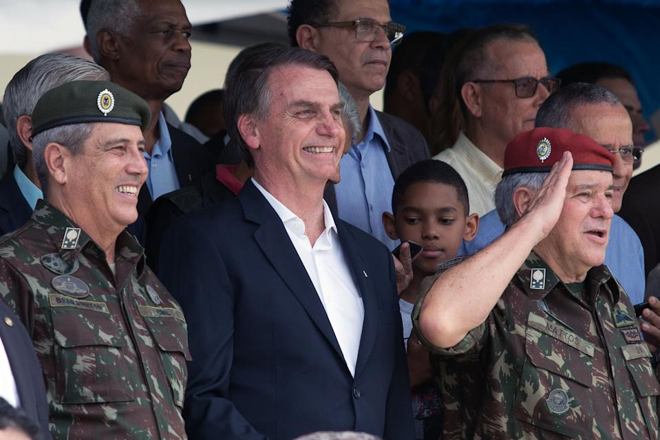 (L to R) Army General Walter Souza Braga Netto, Brazil's President-elect Jair Bolsonaro and Minister of the Brazilian Military Superior Court (STM) General Luis Carlos Gomes Mattos, attend the graduation ceremony of new paratroopers at the Parachute Infantry Battalion Vila Militar, in Rio de Janeiro, Brazil, on November 24, 2018. (Photo by Fernando Souza / AFP)        (Photo credit should read FERNANDO SOUZA/AFP via Getty Images)