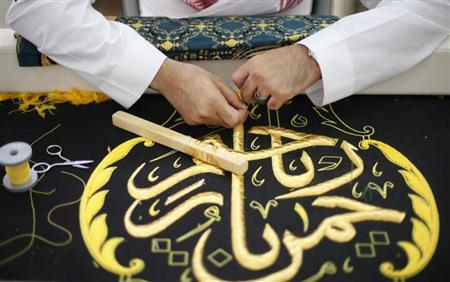 A worker embroiders the Kiswa, a silk cloth covering the Holy Kaaba, in the holy city of Mecca, ahead of the annual haj pilgrimage October 8, 2013. REUTERS/Ibraheem Abu Mustafa