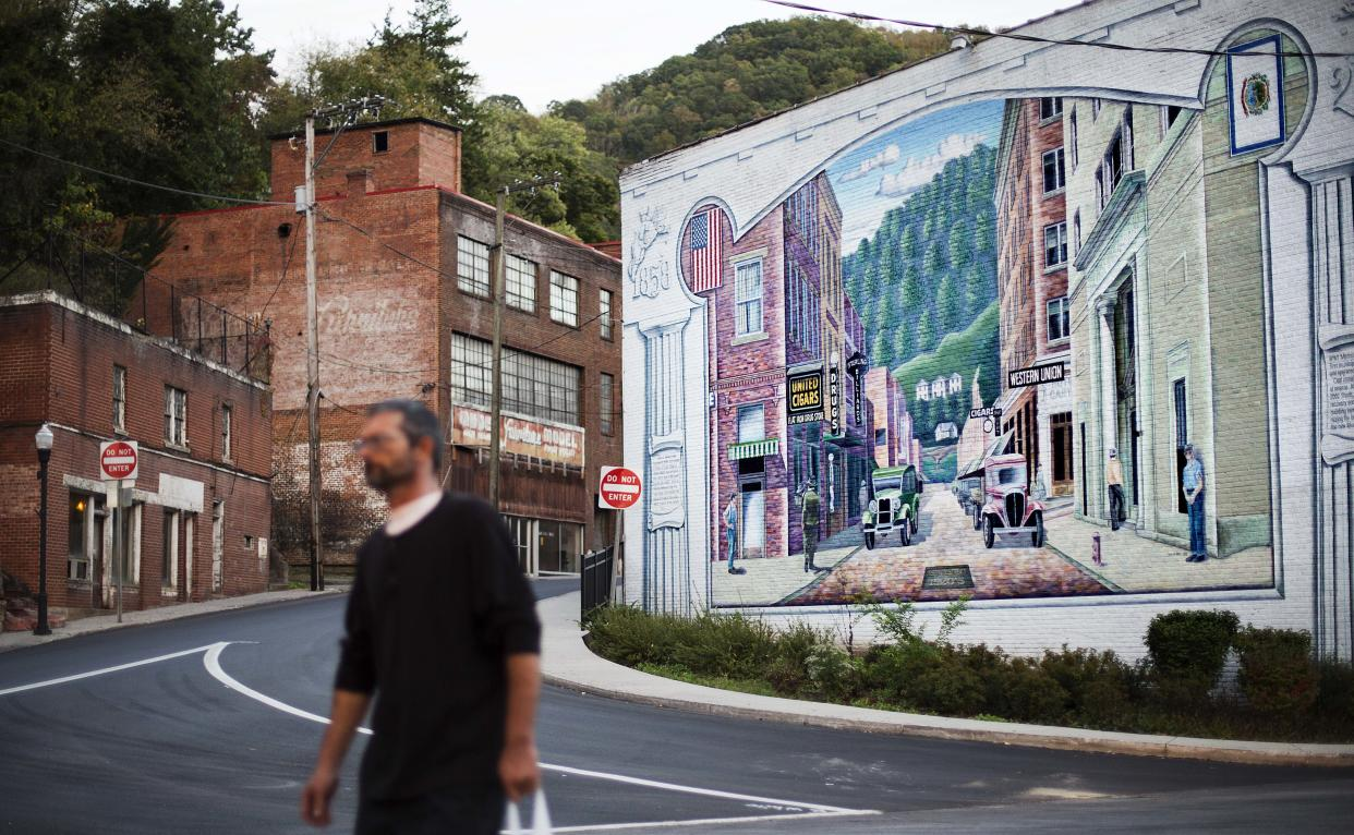 A mural, seen in October 2015, depicting a more vibrant time in the town's history decorates a building in the business district in Welch, W.Va. (Photo: David Goldman/AP)