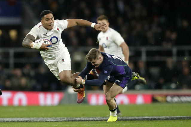 FILE - In this March 16, 2019, file photo, England's Manu Tuilagi, left, is tackled by Scotland's Darcy Graham during the Six Nations rugby union international between England and Scotland at Twickenham stadium in London. England has had wild fortunes this Rugby World Cup cycle under Eddie Jones but appears to be running into good form ahead of the tournament in Japan. (AP Photo/Tim Ireland File)