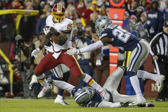 Adrian Peterson (left) ran for 99 yards in the Redskins' 20-17 victory over the Cowboys. (AP)