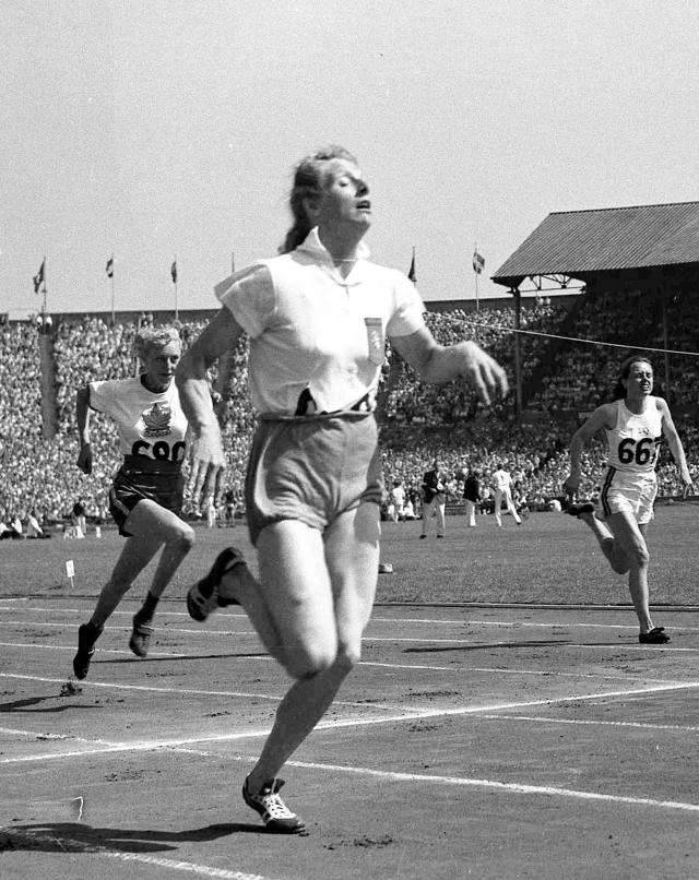 FILE - In this July 31, 1948 file photo, Fanny Blankers-Koen of Holland, foreground, wins heat one of the women's 100-metres Olympic Games competition, at Wembley Stadium, London. Viola Myers from Canada, left, and B.L. McKinnon of Australia attempt to catch the leader. Women were limited in what they could do at the 1948 London Olympics so it was ironic that the biggest personality was a mother of two. Fanny Blankers-Koen was 30, the oldest woman among the track and field entries and considered past her prime. But she won the 100 and 200 meters, the 80-meter hurdles and the 4x100-meter relay. She remains the only female track and field athlete to win four gold medals at a single Olympics. (AP Photo, File)