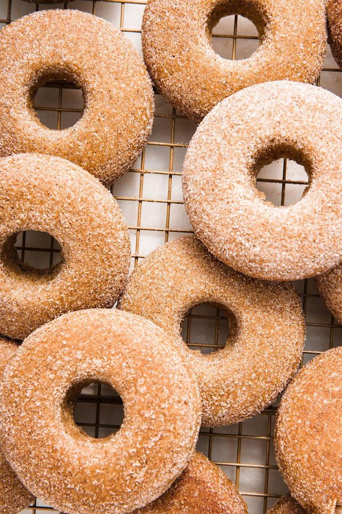 """<p>You can enjoy donuts for breakfast, lunch, and dinner thanks to these vegan beauties.</p><p>Get the recipe from <a href=""""https://www.delish.com/cooking/recipe-ideas/a25429705/vegan-donuts/"""" rel=""""nofollow noopener"""" target=""""_blank"""" data-ylk=""""slk:Delish"""" class=""""link rapid-noclick-resp"""">Delish</a>.</p>"""