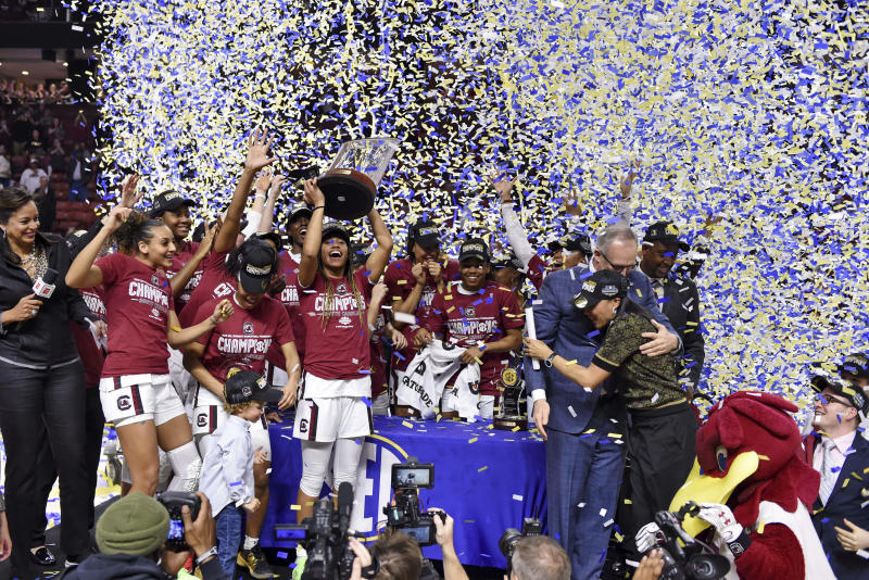 South Carolina celebrates after defeating Mississippi State in a championship match at the Southeastern Conference women's NCAA college basketball tournament in Greenville, S.C., Sunday, March 8, 2020. (AP Photo/Richard Shiro)