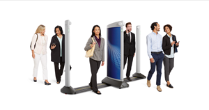 Venue patrons walking through Evolv Express™ touchless security screening system; Express can screen up to 3,600 people per hour—10 times faster than legacy approaches.