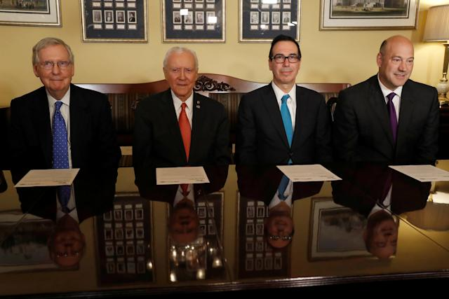 (L-R) Senate Majority Leader Mitch McConnell, Sen. Orrin Hatch, Treasury Secretary Steve Mnuchin and Director of the National Economic Council Gary Cohn introduce the Republican tax reform plan at the U.S. Capitol in Washington,  (Aaron Bernstein / Reuters)