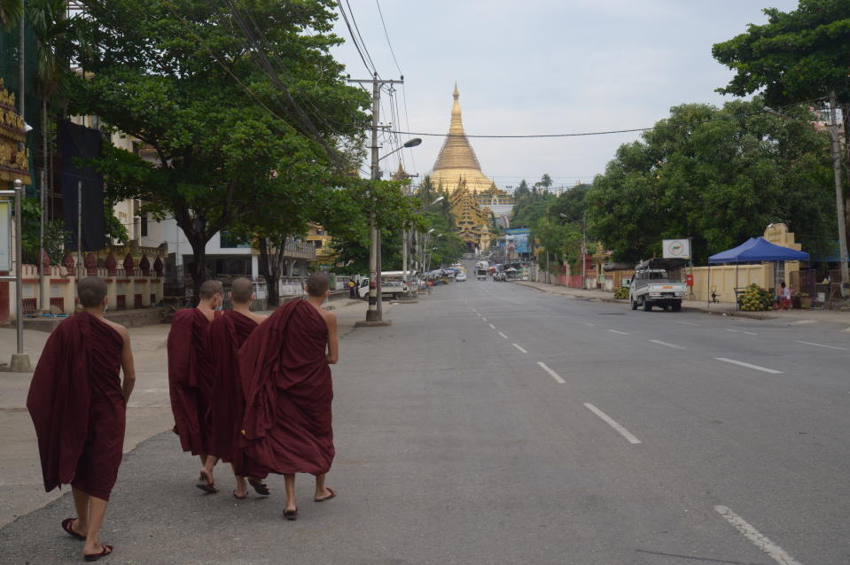 Young Buddhist monks walk on a road leading to the Shwedagon Pagoda in Yangon, Myanmar Friday, April 16, 2021. Opponents of Myanmar's ruling junta went on the political offensive Friday, declaring they have formed an interim National Unity Government comprising elements of the ousted government of Aung San Suu Kyi as well as prominent members of major ethnic minority groups. (AP Photo)
