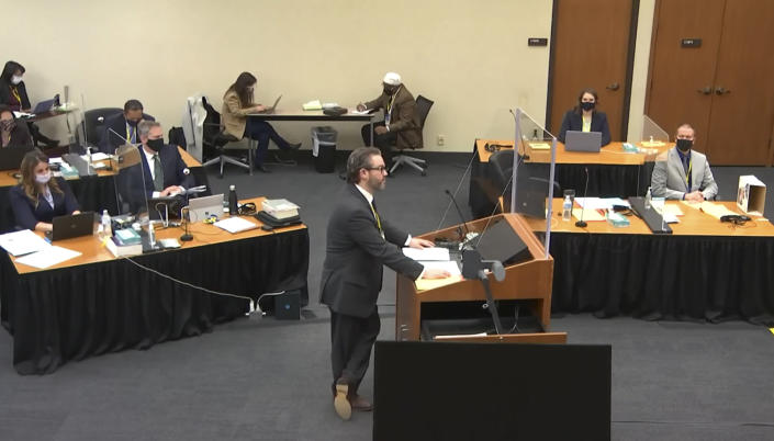In this screen grab from video, defense attorney Eric Nelson, center, listens as Hennepin County Judge Peter Cahill presides over jury selection in the trial of former Minneapolis police officer Derek Chauvin, Wednesday, March 17, 2021 at the Hennepin County Courthouse in Minneapolis, Minn. Chauvin is charged in the May 25, 2020 death of George Floyd. (Court TV, via AP, Pool)