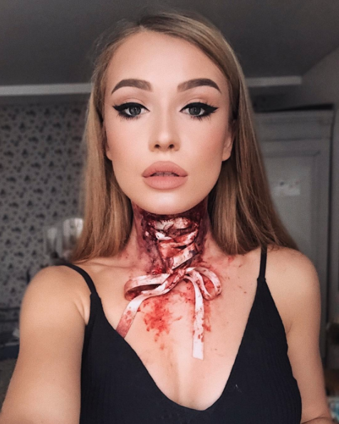 This artist's face looks normal enough until you get to the bloody hole in her throat. Photo: Instagram