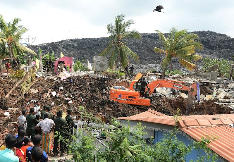 Hundreds of soldiers have kept up the search for survivors amid reports that at least six people were still missing after the disaster (AFP Photo/LAKRUWAN WANNIARACHCHI)