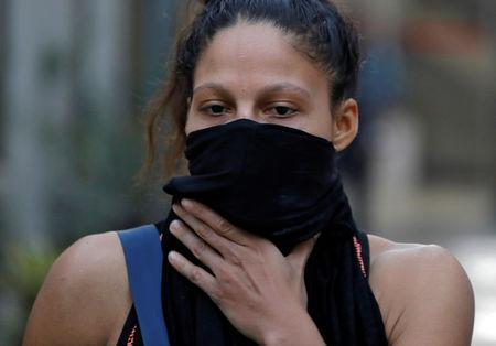 Colombian boxer Dayana Cordero covers her face with a cloth after her practice session ahead of AIBA Women's World Boxing Championships at Indira Gandhi Indoor Stadium in New Delhi, India, November 12, 2018. REUTERS/Anushree Fadnavis