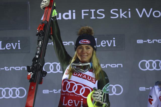 United States' Mikaela Shiffrin celebrates on the podium after winning alpine ski, women's slalom in Levi, Finland, Saturday, Nov. 23, 2019. (AP Photo/Alessandro Trovati)