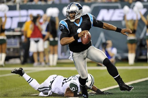 Carolina Panthers quarterback Cam Newton (1) avoids a tackle by New York Jets linebacker Aaron Maybin (51) during the first half of a preseason NFL football game, Sunday, Aug. 26, 2012, in East Rutherford, N.J. (AP Photo/Bill Kostroun)