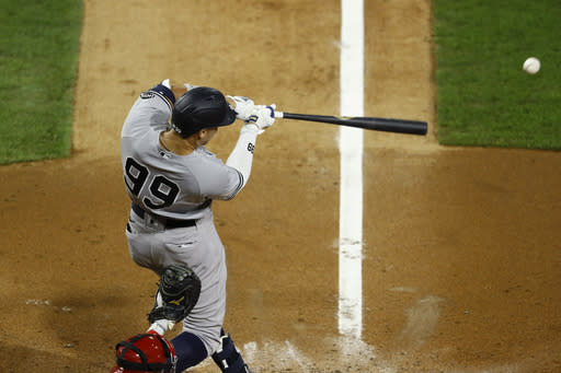 New York Yankees' Aaron Judge hits a single off Philadelphia Phillies starting pitcher Aaron Nola during the fourth inning of the second baseball game in a doubleheader, Wednesday, Aug. 5, 2020, in Philadelphia. (AP Photo/Matt Slocum)