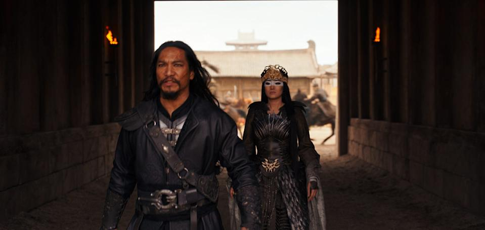 "Jason Scott Li (L) is Böri Khan in ""Mulan"" working with Xianniang (Gong Li) to defeat the Emperor."