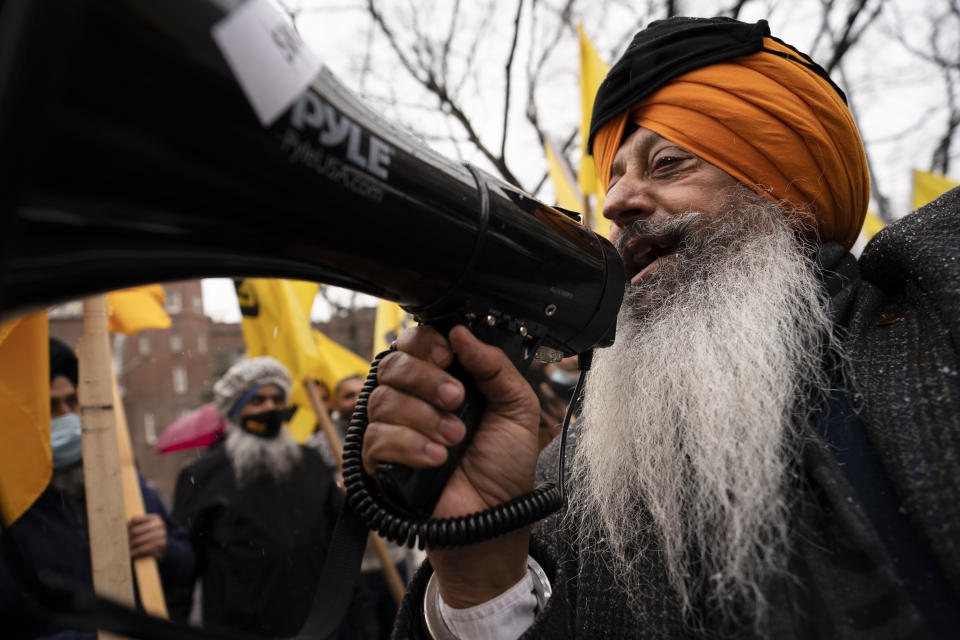 Protesters lead chants outside the Consulate General of India, Tuesday, Jan. 26, 2021, in the Manhattan borough of New York. Tens of thousands of protesting farmers have marched, rode horses and drove long lines of tractors into India's capital, breaking through police barricades to storm the historic Red Fort. The farmers have been demanding the withdrawal of new laws that they say will favor large corporate farms and devastate the earnings of smaller scale farmers. Republic Day marks the anniversary of the adoption of India's constitution on Jan. 26, 1950. (AP Photo/John Minchillo)