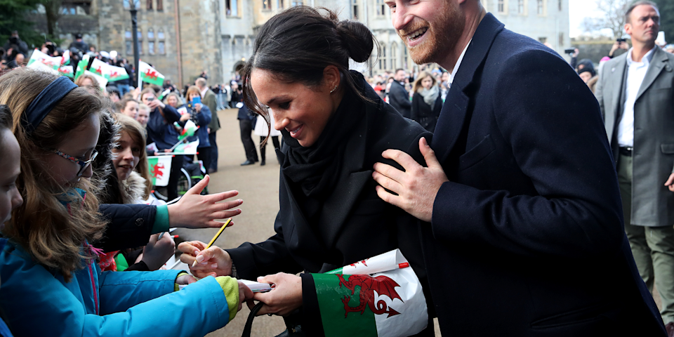 """<p>Royals aren't supposed to sign autographs for the simple reason that it makes their handwriting available to people who might use it for nefarious purposes, but during a January visit to Wales, Meghan broke this rule (or came up with a clever workaround, depending on who you ask). When 10-year-old Caitlin Clarke asked for her signature, Meghan wrote, """"Hi Kaitlin,"""" thus signing without actually signing her own name. Caitlin was so excited that she didn't care that Meghan spelled her name wrong. """"I've never got a royal autograph before,"""" she <a href=""""http://people.com/royals/meghan-markle-broke-royal-protocol-hollywood-habit/"""" rel=""""nofollow noopener"""" target=""""_blank"""" data-ylk=""""slk:told"""" class=""""link rapid-noclick-resp"""">told</a> reporters. """"This is going to make everyone jealous.""""</p>"""