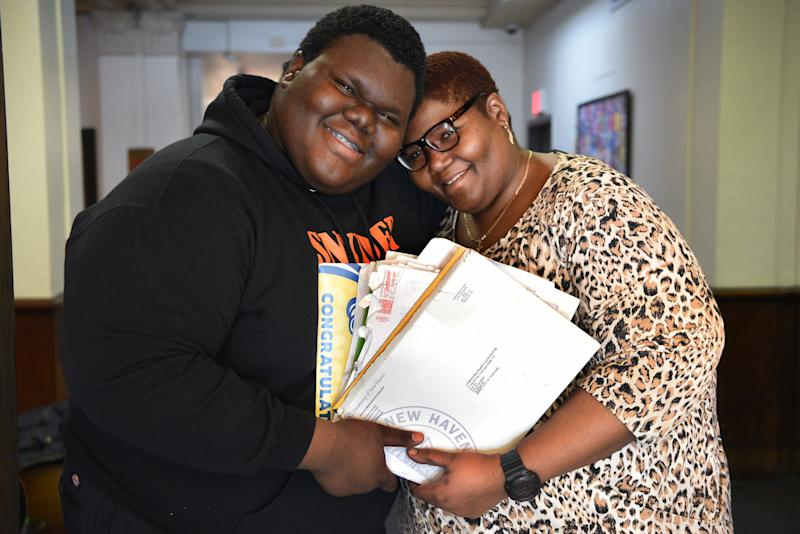 """Formerly homeless student Dylan Chidick of Jersey City, NJ and his mother Khadine Phillip, hold his seventeen acceptance letters from college. On Thursday, March 14, 2019 Chidick also received a full scholarship for tuition, room and board from """"Give Something Back."""" Chidick and his mother, Khadine Phillip received housing from Women Rising in Jersey in August 2017."""