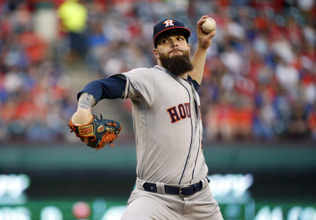 Houston Astros starting pitcher Dallas Keuchel (60) throws against the Texas Rangers during the first inning of a baseball game Friday, March 30, 2018, in Arlington, Texas. (AP Photo/Michael Ainsworth)