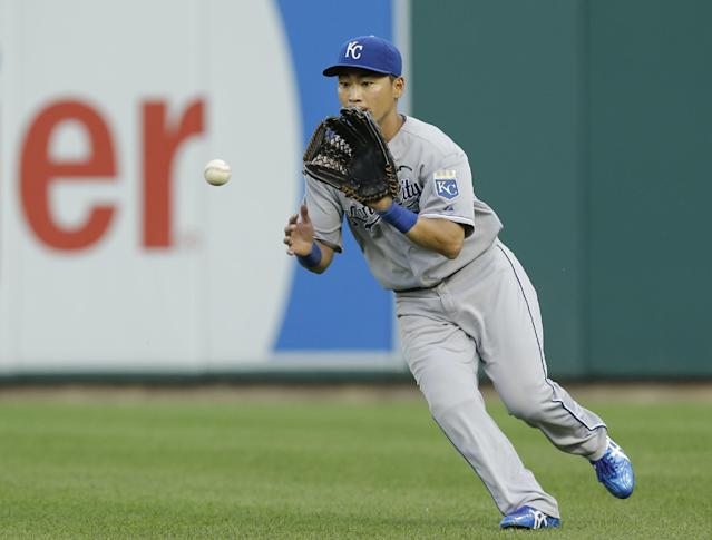 Kansas City Royals right fielder Norichika Aoki fields a Detroit Tigers' Torii Hunter ground ball in the fourth inning of a baseball game in Detroit, Monday, June 16, 2014. (AP Photo/Paul Sancya)