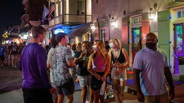 PHOTO: People walk down Bourbon Street as Louisiana rises to worst COVID-19 outbreak in U.S. amid Delta variant, in New Orleans, July 23, 2021. (Kathleen Flynn/Reuters)