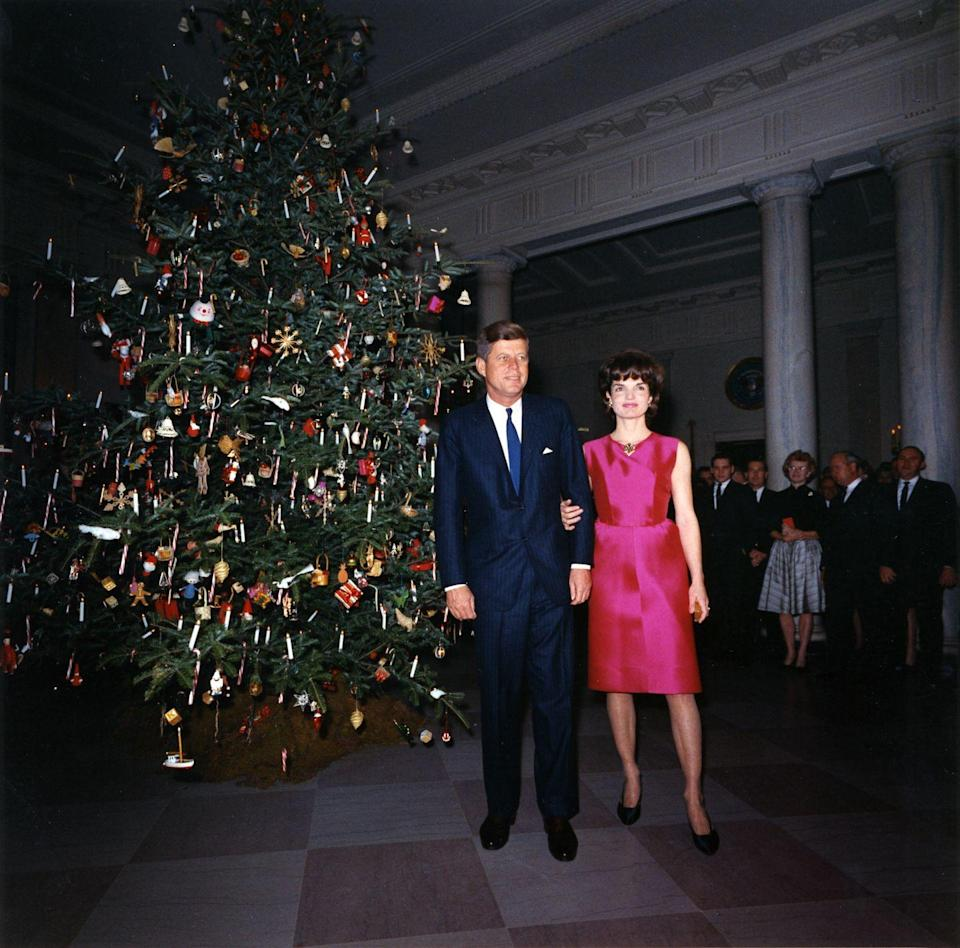 <p>This photograph shows the Christmas tree in the entrance hall, as the White House was being restored under Jackie's careful study of American architecture.</p>