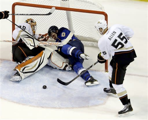 St. Louis Blues' Alexander Steen, center, collides with Anaheim Ducks goalie Viktor Fasth, left, of Sweden, as Ducks' Bryan Allen, right, clears the puck during the third period of an NHL hockey game, Saturday, Feb. 9, 2013, in St. Louis. The Ducks won 6-5 in a shootout. (AP Photo/Jeff Roberson)