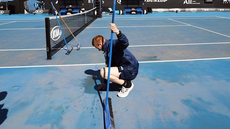 Australian Open play delayed by rain and dust