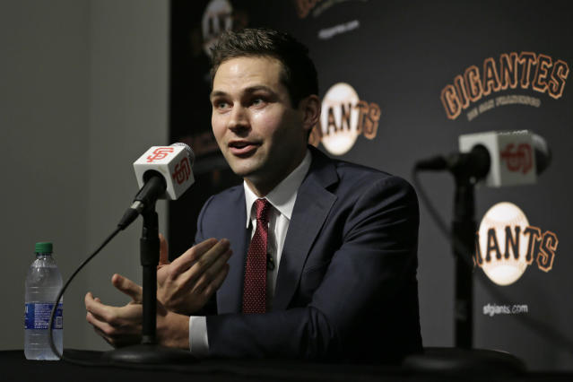 San Francisco Giants general manager Scott Harris gestures during a news conference after his introduction at Oracle Park Monday, Nov. 11, 2019, in San Francisco. The Giants hired Harris from the Chicago Cubs to become general manager, filling a void of more than a year after the club had gone without a GM during president of baseball operations Farhan Zaidi's first season in the position. (AP Photo/Eric Risberg)