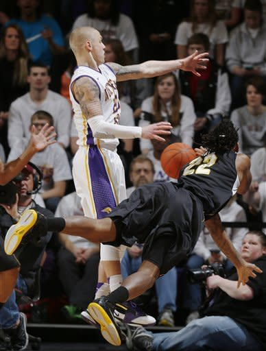 Northern Iowa guard Marc Sonnen, left, blocks a pass by Wichita State forward Carl Hall, right, during the first half of an NCAA college basketball game on Saturday, Feb. 2, 2013, in Cedar Falls, Iowa. (AP Photo/Matthew Putney)