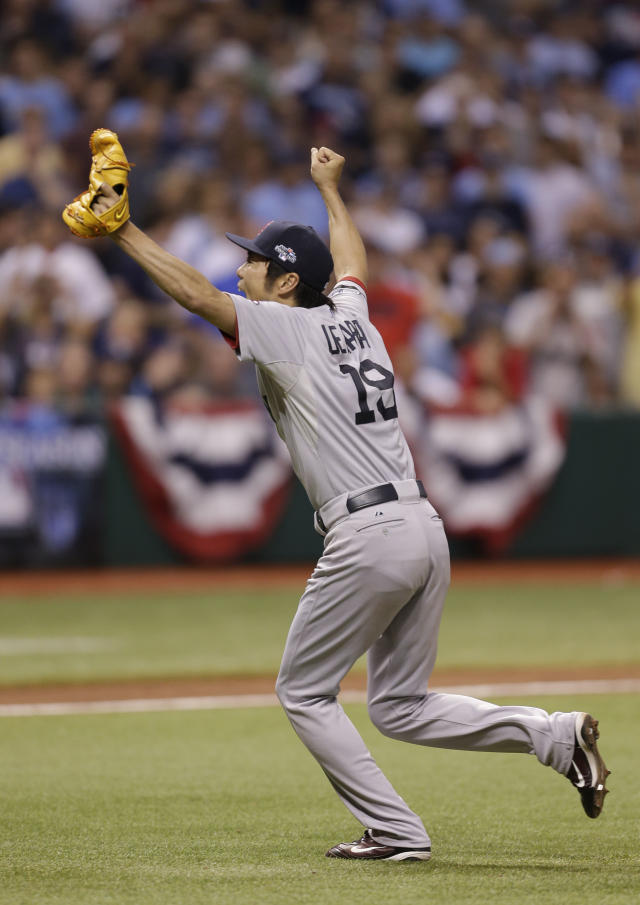 Boston Red Sox pitcher Koji Uehara (19) raises his arms after defeating the Tampa Bay Rays in Game 4 of an American League baseball division series, Wednesday, Oct. 9, 2013, in St. Petersburg, Fla. The Boston Red Sox's defeated the Tampa Bay Rays 3-1 to move on to the American League Championship Series. (AP Photo/Chris O'Meara)