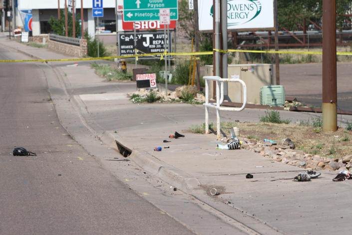 This Saturday, June 19, 2021, photo courtesy of The White Mountain Independent shows the scene of an accident after a pick up truck ran over a group of cyclists in Show Low, Ariz. A driver in a pickup truck plowed into bicyclists competing in a community road race in Arizona on Saturday, critically injuring several riders before police chased down the driver and shot him outside a nearby hardware store, police said. (Jim Headley/The White Mountain Independent via AP)
