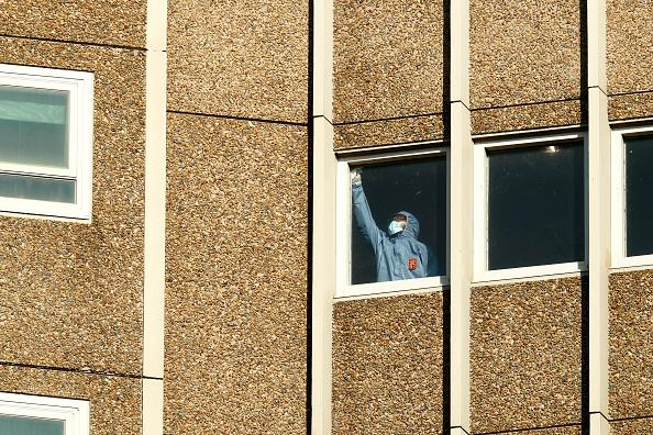 Cleaning takes place inside the Alfred Street Public Housing Complex in North Melbourne.