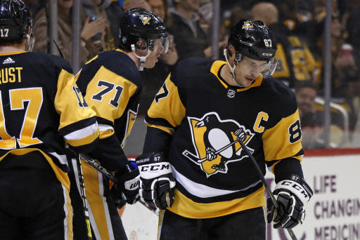 Pittsburgh Penguins' Evgeni Malkin (71) skates to the bench after scoring his second goal of the night, during the second period of the team's NHL hockey game against the Minnesota Wild in Pittsburgh, Tuesday, Jan. 14, 2020. Sidney Crosby had an assist on the goal, his second of the game. (AP Photo/Gene J. Puskar)
