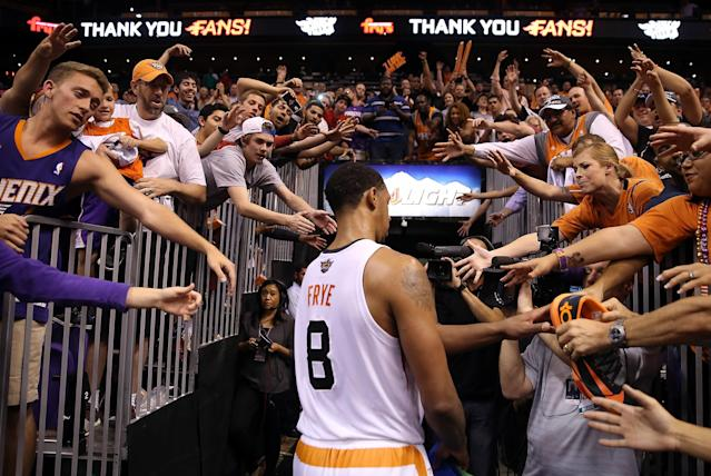 PHOENIX, AZ - APRIL 14: Fans reach for Channing Frye #8 of the Phoenix Suns as he walks off the court following the NBA game against the Memphis Grizzlies at US Airways Center on April 14, 2014 in Phoenix, Arizona. The Grizzlies defeated the 97-91. NOTE TO USER: User expressly acknowledges and agrees that, by downloading and or using this photograph, User is consenting to the terms and conditions of the Getty Images License Agreement. (Photo by Christian Petersen/Getty Images)