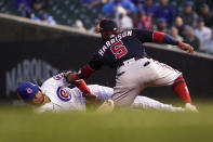 Chicago Cubs' Willson Contreras, left, slides in to second as Washington Nationals second baseman Josh Harrison makes a tag during the third inning of a baseball game Tuesday, May 18, 2021, in Chicago. Contreras was originally ruled safe with a steal, but the call was overturned on review. (AP Photo/Charles Rex Arbogast)