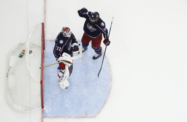 Columbus Blue Jackets' Sergei Bobrovsky, of Russia, and David Savard celebrate their win over the Tampa Bay Lightning in Game 4 of an NHL hockey first-round playoff series, Tuesday, April 16, 2019, in Columbus, Ohio. (AP Photo/Jay LaPrete)