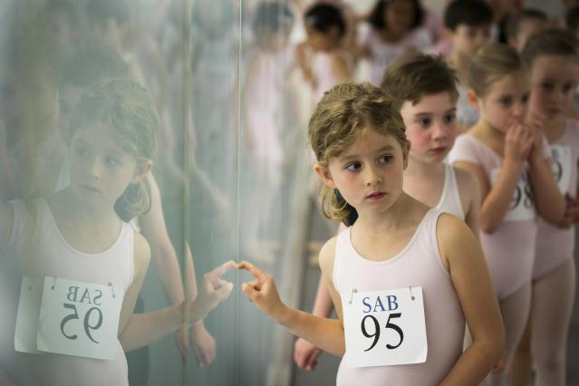 Children wait for their turn during an audition for the School of American Ballet in New York April 25, 2014. The school is holding auditions for over 600 beginner ballet students, who will be selected to fill the 120 spots available to study on campus. REUTERS/Lucas Jackson (UNITED STATES - Tags: SOCIETY EDUCATION)