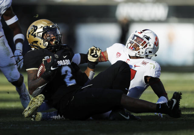 Colorado wide receiver Laviska Shenault Jr., left, is pulled down after a short gain by Stanford cornerback Kyu Blu Kelly in the second half of an NCAA college football game, Saturday, Nov. 9, 2019, in Boulder, Colo. Colorado won 16-13. (AP Photo/David Zalubowski)