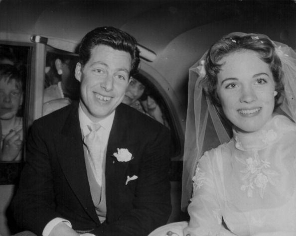<p>The <em>Mary Poppins </em>star and her newly minted husband, costume designer Anthony Walton, share a smile on their wedding day on May 11th, 1959. The two stayed together until 1967 and shared one child together. They both went on to marry once more. </p>