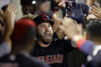 Cleveland Indians' Jason Kipnis celebrates in the dugout after a two-run home run against the Los Angeles Angels during the second inning of a baseball game in Anaheim, Calif., Monday, Sept. 9, 2019. (AP Photo/Chris Carlson)