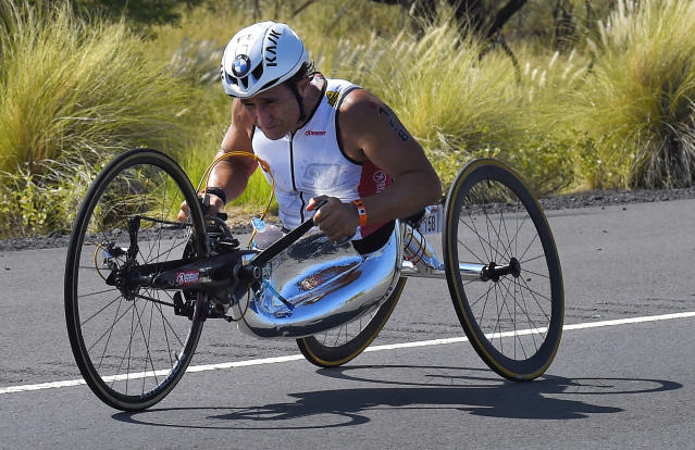 FILE - In this Saturday, Oct. 10, 2015 file photo, Alex Zanardi, of Italy, rides during the cycling portion of the Ironman World Championship Triathlon, in Kailua-Kona, Hawaii. Race car driver turned Paralympic champion Alex Zanardi has been seriously injured again. Police tell The Associated Press that Zanardi was transported by helicopter to a hospital in Siena following a road accident near the Tuscan town of Pienza during a national race for Paralympic athletes on handbikes. The 53-year-old Zanardi had both of his legs amputated following a horrific crash during a 2001 CART race in Germany. He was a two-time CART champion. (AP Photo/Mark J. Terrill, File)