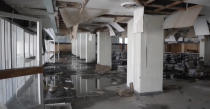 <p>For the last 44 years, the airport has slowly decomposed and crumbled, with the once comfy chairs in the lounges smothered in pigeon feces and amassed in dust. (Photo: Bob Thissen/Caters News) </p>