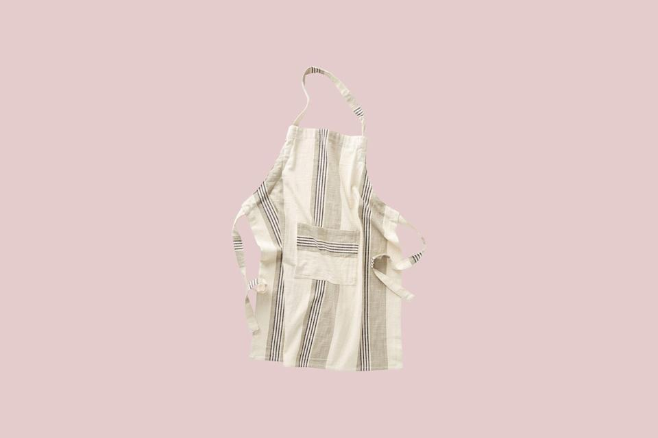 """<p>An attractive apron that's easy to throw on is a gift that keeps on giving. This sleek striped stunner is composed of super lightweight cotton and ties up in the back for quick removal.</p> <p><strong><em>Shop Now: </em></strong><em>Anthropologie Eatery Striped Apron, $34, <a href=""""https://click.linksynergy.com/deeplink?id=93xLBvPhAeE&mid=39789&murl=https%3A%2F%2Fwww.anthropologie.com%2Fshop%2Featery-striped-apron&u1=MSL12StylishApronsThatHaveYouCoveredintheKitchensmeyerKitGal7844953202007I"""" rel=""""nofollow noopener"""" target=""""_blank"""" data-ylk=""""slk:anthropologie.com"""" class=""""link rapid-noclick-resp"""">anthropologie.com</a></em><em>.</em></p>"""